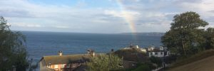 Header image showing a rainbow over Scarborough south bay